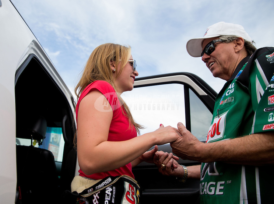 Feb 23, 2014; Chandler, AZ, USA; Funny car driver John Force (right) consoles daughter NHRA top fuel dragster driver Brittany Force after losing in her first final round appearance at the Carquest Auto Parts Nationals at Wild Horse Motorsports Park. Mandatory Credit: Mark J. Rebilas-USA TODAY Sports