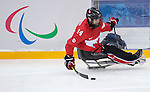 Sochi, RUSSIA - Mar 13 2014 - Steve Arsenault as Canada takes on USA in Sledge Hockey Semi-Final at the 2014 Paralympic Winter Games in Sochi, Russia.  (Photo: Matthew Murnaghan/Canadian Paralympic Committee)