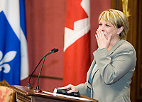 Quebec City, April 18, 2007 - Christine Saint-Pierre shows emotion as she is sworn in as the new communication, culture and feminine condition minister at the Red room of the National assembly in Quebec City April 18, 2007. The cabinet is one of the smallest of the recent years and includes an equal number of men and women.<br /> <br /> PHOTO :  Francis Vachon - Agence Quebec Presse