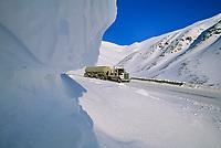 Semi tractor trailer travels down north side of Atigun Pass, James Dalton Highway, Brooks Range, Alaska