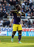 Pictured: Wilfried Bony of Swansea celebrating his goal from the penalty spot after Marvin Emnes was brought dowin in the box in stoppage time. Saturday 19 April 2014<br /> Re: Barclay's Premier League, Newcastle United v Swansea City FC at St James Park, Newcastle, UK.