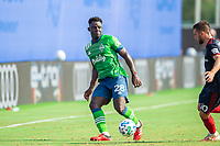 LAKE BUENA VISTA, FL - JULY 14: Yeimar Gomez #28 of the Seattle Sounders kicks the ball during a game between Seattle Sounders FC and Chicago Fire at Wide World of Sports on July 14, 2020 in Lake Buena Vista, Florida.