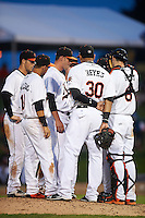 Frederick Keys relief pitcher Michael Zouzalik (28, center) talks with manager Keith Bodie (hidden) as Jonah Heim (6), Jomar Reyes (30), Erick Salcedo (19) Stephen Wilkerson (17), and Cameron Kneeland (39) listen in during a game against the Carolina Mudcats on June 4, 2016 at Nymeo Field at Harry Grove Stadium in Frederick, Maryland.  Frederick defeated Carolina 5-4 in eleven innings.  (Mike Janes/Four Seam Images)