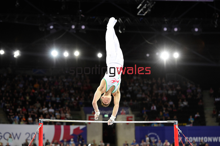 Wales' Iwan Mepham during his routine on the horizontal bar in the WAG individual qualification and team final<br /> <br /> Photographer Chris Vaughan/SPORTINGWALES<br /> <br /> 20th Commonwealth Games - Day 6 - Tuesday 29th July 2014 - Gymnastics Artistic - The SSE Hydro - Glasgow - UK