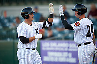 Florida Fire Frogs catcher Alex Jackson (25) is congratulated by Braxton Davidson (24) after hitting a home run in the bottom of the fourth inning during a game against the Dunedin Blue Jays on April 10, 2017 at Osceola County Stadium in Kissimmee, Florida.  Florida defeated Dunedin 4-0.  (Mike Janes/Four Seam Images)
