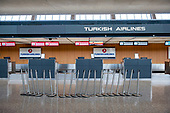 The morning hours are quiet at Turkish Airlines, at the international terminal at Dulles International Airport in Dulles, Va., Monday, March16, 2020. Some people are taking the precaution of wearing face masks as they arrive to be greeted by family and or friends. Credit: Rod Lamkey / CNP