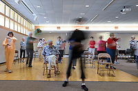 USA, Nebraska, Omaha, Tai-Chi for senior citizen, blurred due to long time exposure