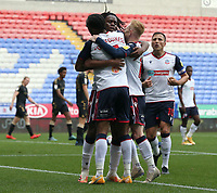 Bolton Wanderers' Nathan Delfouneso celebrates scoring his sides only goal with team-mate Peter Kioso and Ali Crawford <br /> <br /> Photographer Stephen White/CameraSport<br /> <br /> The EFL Sky Bet League Two - Bolton Wanderers v Oldham Athletic - Saturday 17th October 2020 - University of Bolton Stadium - Bolton<br /> <br /> World Copyright © 2020 CameraSport. All rights reserved. 43 Linden Ave. Countesthorpe. Leicester. England. LE8 5PG - Tel: +44 (0) 116 277 4147 - admin@camerasport.com - www.camerasport.com