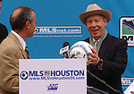 Houston Mayor Bill White receives a soccer ball from team coach Dominic Kinnear during a news conference welcoming Major League Soccer to Houston outside Houston City Hall Friday Dec. 16,2005.