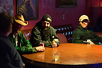 November 8, 2013. Chapel Hill, North Carolina.<br />  (right to left) Will Mallet, Brian Higgins and Luke Mallett talk with some locals before the show.<br />  The Mallett Bros. Band played a 2.5 hour set at the Kraken on the last leg of a 6 week tour of the US, before heading for a wedding in Maryland and then their last show in Nashville, where they will open for their father.