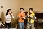Education Elementary School New York Grade 3 arts enrichment music children singing during chorus class horizontal gesturing and acting