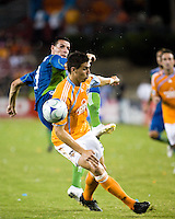Houston Dynamo defender Geoff Cameron (2) steals the ball from Seattle Sounders midfielder Sebastien Le Toux (9).  Houston Dynamo tied Seattle Sounders 1-1 on August 23, 2009 at Robertson Stadium in Houston, TX.