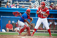 Auburn Doubledays catcher Andruth Ramirez #6 looks for a ball in the dirt in front of Jacob Wilson #32 at bat during a NY-Penn League game against the Batavia Muckdogs at Dwyer Stadium on September 3, 2012 in Batavia, New York.  Auburn defeated Batavia 5-3.  (Mike Janes/Four Seam Images)