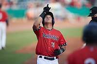 Heriberto Hernandez (11) of the Charleston RiverDogs points to the sky after hitting a home run against the Augusta GreenJackets at Joseph P. Riley, Jr. Park on June 25, 2021 in Charleston, South Carolina. (Brian Westerholt/Four Seam Images)