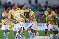 MELBOURNE, AUSTRALIA - DECEMBER 27: Ljubo Milicevic of the Jets and his team mates celebrate a goal by Ruben Zadkovich during the round 20 A-League match between the Melbourne Victory and the Newcastle Jets at AAMI Park on December 27, 2010 in Melbourne, Australia. (Photo by Sydney Low / Asterisk Images)