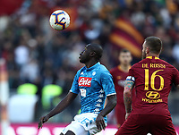 Football, Serie A: AS Roma - SSC Napoli, Olympic stadium, Rome, March 31, 2019. <br /> Napoli's Kalidou Koulibaly (l) in action with Roma's captain Daniele De Rossi (r) during the Italian Serie A football match between Roma and Napoli at Olympic stadium in Rome, on March 31, 2019.<br /> UPDATE IMAGES PRESS/Isabella Bonotto
