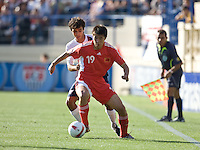 Jonathan Bornstein defends against Dong Fangzhuo. The USA defeated China, 4-1, in an international friendly at Spartan Stadium, San Jose, CA on June 2, 2007.