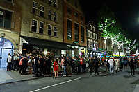 Pictured: People queue outside the Peppermint in Wind Street, Swansea, Wales, UK. Saturday 07 August 2021<br /> Re: Nightclubs have reopened this weekend as most Covid restrictions have come to an end in Wales, UK.<br /> Pubs and restaurants were allowed to open for certain periods, with safety measures in place unlike nightclubs.