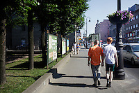 Pavel Lebedev (L), 23, walking hand-in-hand with his boyfriend Kirill Kalugin through the streets of St. Peterburg . Pavel says that he has been violently attacked six times in the previous year. In spite of the danger he insists he has the right to be open about his sexuality, and to choose who he loves. On 30 June 2013, Russian President Vladimir Putin signed into law an ambiguous bill banning the 'propaganda of nontraditional sexual relations to minors'. The law met with widespread condemnation from human rights and LGBT groups. (MANDATORY CREDIT   photo: Mads Nissen/Panos Pictures /Felix Features)