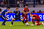Doan Ritsu of Japan (L2) fights for the ball with B T Dung of Vietnam (R2) during the AFC Asian Cup UAE 2019 Quarter Finals match between Vietnam (VIE) and Japan (JPN) at Al Maktoum Stadium on 24 January 2018 in Dubai, United Arab Emirates. Photo by Marcio Rodrigo Machado / Power Sport Images