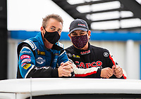 Oct 18, 2020; Ennis, Texas, USA; NHRA top fuel driver Clay Millican (left) and Billy Torrence during the Fall Nationals at Texas Motorplex. Mandatory Credit: Mark J. Rebilas-USA TODAY Sports
