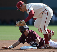 Arkansas second baseman Robert Moore (right) applies the tag Wednesday, April 7, 2021, to UALR third baseman Nathan Lyons for the first out of the inning during the Razorbacks' 10-3 win at Baum-Walker Stadium in Fayetteville. Visit nwaonline.com/210408Daily/ for today's photo gallery. <br /> (NWA Democrat-Gazette/Andy Shupe)