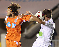 Tom Heinemann #31 Of the Carolina Railhawks heads the ball into Joshua Hansen #20 of the Puerto Rico Islanders during the second leg of the USSF-D2 championship match at WakeMed Soccer Park, in Cary, North Carolina on October 30 2010. The game ended 1-1, Puerto Rico won on overall goals 3-1.