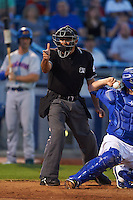 Umpire Nestor Ceja makes a strike call during a game between the Midland RockHounds and Tulsa Drillers on June 2, 2015 at Oneok Field in Tulsa, Oklahoma.  Midland defeated Tulsa 6-5.  (Mike Janes/Four Seam Images)