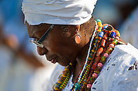 A priestess of Candomblé (Mãe-de-santo, iyalorishá) seen during the ritual procession in honor to Yemanjá, the goddess of the sea, in Amoreiras, Bahia, Brazil, 3 February 2012. Yemanjá, originally from the ancient Yoruba mythology, is one of the most popular ?orixás?, the deities from the Afro-Brazilian religion of Candomblé. Every year on February 3rd, hundreds of Yemanjá devotees participate in a colorful celebration in her honor. Faithful, usually dressed in the traditional white, gather at the beach on Itaparica island to leave offerings for their goddess. Gifts for Yemanjá include flowers, perfumes or jewelry. Dancing in the circle and singing ancestral Yoruba prayers, sometimes the followers enter into a trance and become possessed by the spirits. Although Yemanjá is widely worshipped throughout Latin America, including south of Brazil, Uruguay, Cuba or Haiti, the most popular cult is maintained in Bahia, Brazil.