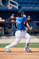 Biloxi Shuckers second baseman Javier Betancourt (7) follows through on a swing during a game against the Jackson Generals on April 23, 2017 at MGM Park in Biloxi, Mississippi.  Biloxi defeated Jackson 3-2.  (Mike Janes/Four Seam Images)