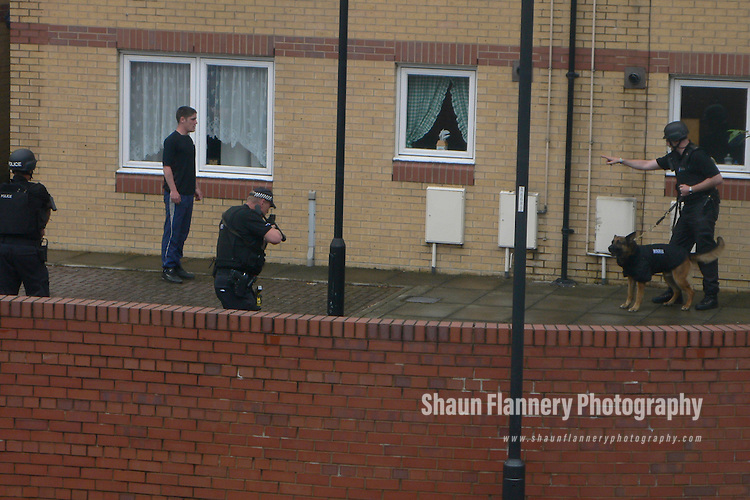 Pix: Alan Elvidge/shaunflanneryphotography.com...COLLECT PICTURE>>SHAUN FLANNERY>01302-570814>>07778315553>>..27th January 2011...........Love Tangle Gun Drama..Armed South Yorkshire Police arrest Frederick Kaye outside his home at Parkinson Street, Doncaster..Story: Martyn Sharpe