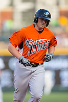 Chris Parmalee (41) of the Norfolk Tides rounds the bases after hitting a home run in the top of the first inning against the Charlotte Knights at BB&T BallPark on April 9, 2015 in Charlotte, North Carolina.  The Knights defeated the Tides 6-3.   (Brian Westerholt/Four Seam Images)