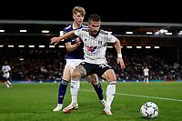 21st September 2021; Craven Cottage, Fulham, London, England; EFL Cup Football Fulham versus Leeds; Joe Bryan of Fulham is challenged by Stuart McKinstry of Leeds United