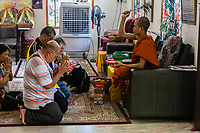 Monk Blessing Worshipers with Holy Water, Dhammikarama Burmese Buddhist Temple, George Town, Penang, Malaysia.