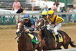 June 12,  2010: Calvin Borel checks Rachel Alexandra just before the wire the first time around in the G1 Fleur De Lis at Churchill Downs in Louisville, Kentucky.