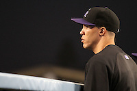 Colorado Rockies pitcher Ubaldo Jimenez #38 watches a game  against the Los Angeles Dodgers at Dodger Stadium on July 26, 2011 in Los Angeles,California. Los Angeles defeated Colorado 3-2.(Larry Goren/Four Seam Images)