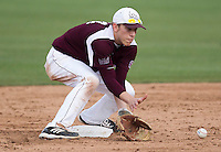 Eric Cheray (14) of the Missouri State Bears fields a ground ball during a game against the Northwestern Wildcats at Hammons Field on March 9, 2013 in Springfield, Missouri. (David Welker/Four Seam Images)