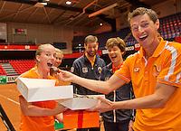 "April 16, 2015, Netherlands, Den Bosch, Maaspoort, Fedcup Netherlands-Australia,  Birthday celebration for Richel Hogenkamp, captain Paul Haarhuis feeds her a ""Bossche Bol""<br /> Photo: Tennisimages/Henk Koster"