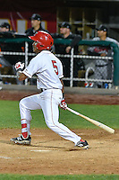 L.J. Kalawaia (5) of the Orem Owlz follows through on his swing against the Billings Mustangs in Game 2 of the Pioneer League Championship at Home of the Owlz on September 16, 2016 in Orem, Utah. Orem defeated Billings 3-2 and are the 2016 Pioneer League Champions.(Stephen Smith/Four Seam Images)