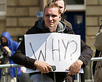 """© Joel Goodman - 07973 332324 . 04/06/2011 . Dewsbury , UK . A man holding a placard with """"WHY?"""" written across it , close to the demonstration . The English Defence League hold a demonstration in Dewsbury  . Photo credit : Joel Goodman"""