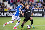 Lucas Vazquez of Real Madrid competes for the ball with Diego Rico of Deportivo Leganes during their La Liga match between Deportivo Leganes and Real Madrid at the Estadio Municipal Butarque on 05 April 2017 in Madrid, Spain. Photo by Diego Gonzalez Souto / Power Sport Images