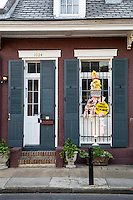 French Quarter, New Orleans, Louisiana.  Shotgun-style House with Window Decoration.