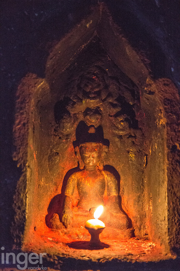 Candle Burning in front of Buddha at Swayambhunath, Nepal