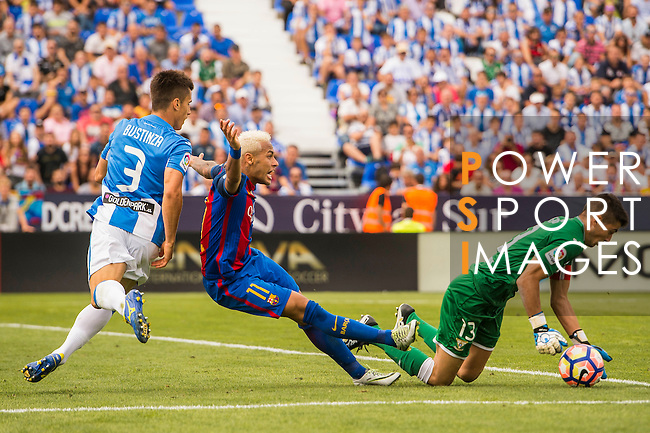 Unai Bustinza (L) of Deportivo Leganes tackles Neymar JR of FC Barcelona during their La Liga match between Deportivo Leganes and FC Barcelona at the Butarque Municipal Stadium on 17 September 2016 in Madrid, Spain. Photo by Diego Gonzalez Souto / Power Sport Images