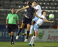 Brittany Bock #5 of the Washington Freedom in action against Megan Rapinoe #7 and Cristiane #11 of the Chicago Red Stars during a WPS match at Maryland Soccerplex on August 19 2010, in Boyds, Maryland. Freedom won 2-0.
