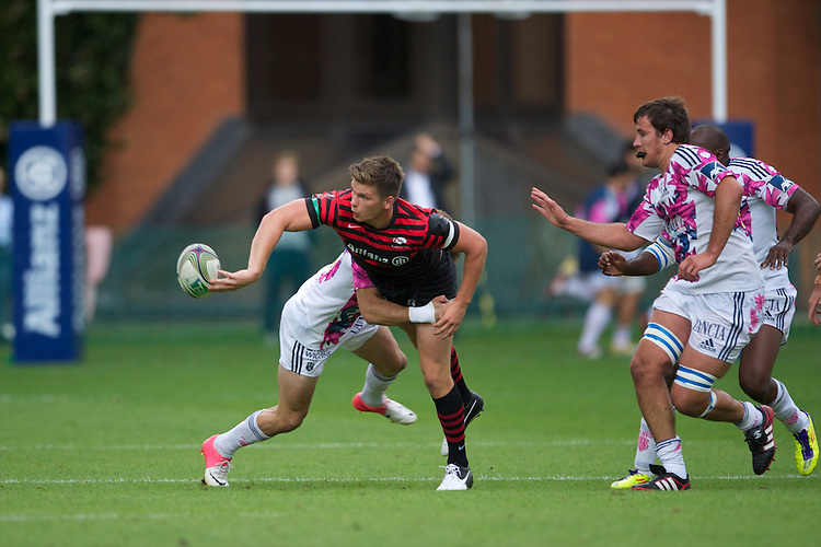 20120823 Copyright onEdition 2012©.Free for editorial use image, please credit: onEdition..Owen Farrell of Saracens offloads as he is tackled by Hugo Bonneval of Stade Francais Paris at The Honourable Artillery Company, London in the pre-season friendly between Saracens and Stade Francais Paris...For press contacts contact: Sam Feasey at brandRapport on M: +44 (0)7717 757114 E: SFeasey@brand-rapport.com..If you require a higher resolution image or you have any other onEdition photographic enquiries, please contact onEdition on 0845 900 2 900 or email info@onEdition.com.This image is copyright the onEdition 2012©..This image has been supplied by onEdition and must be credited onEdition. The author is asserting his full Moral rights in relation to the publication of this image. Rights for onward transmission of any image or file is not granted or implied. Changing or deleting Copyright information is illegal as specified in the Copyright, Design and Patents Act 1988. If you are in any way unsure of your right to publish this image please contact onEdition on 0845 900 2 900 or email info@onEdition.com