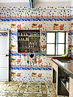 The kitchen is a riot of colour and pattern.  While the materials used are practical, the overall effect is wonderfully decorative