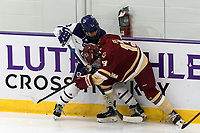 WORCESTER, MA - JANUARY 16: Carly Beniek #10 of Holy Cross and Jillian Fey #13 of Boston College battle for the puck during a game between Boston College and Holy Cross at Hart Center Rink on January 16, 2021 in Worcester, Massachusetts.
