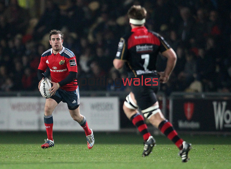 Full back JJ Hanrahan of Munster Rugby looks to run with the ball.<br /> <br /> Guiness Pro 12<br /> Newport Gwent Dragons v Munster Rugby<br /> Rodney Parade<br /> 21.11.14<br /> ©Steve Pope-SPORTINGWALES