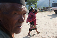 A mother carries her injured daughter Nikita,14, on her back. Out side of Kathmandu, Nepal. May 05, 2015